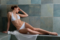 Turkish bath. Beautiful young woman relaxing in a Turkish bath at spa Royalty Free Stock Images