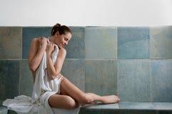 Turkish bath. Beautiful young woman relaxing in a Turkish bath at spa Stock Photo
