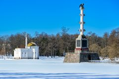 Turkish bath and Chesme Column in the Catherine park in Pushkin, St.Petersburg, Russia. Winter landscape of the Great Pond in Landscape Park (the Catherine Park stock photos