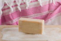 Foam soap on the wood. Turkish bath foam soap on the board royalty free stock images