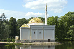 Turkish bath. On the lake shore in the Catherine Park sky clouds gold dome water Royalty Free Stock Images