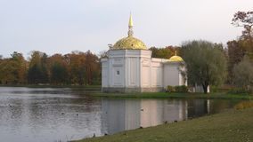 The Turkish bath pavilion on the bank of a pond, cloud october day. Tsarskoye Selo. SAINT PETERSBURG, RUSSIA - OCTOBER 17, 2017: The Turkish bath pavilion on the stock video