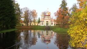 The Turkish bath pavilion on the bank of a pond, cloudy october day. Tsarskoye Selo. The Turkish bath pavilion on the bank of a pond, cloudy october day stock footage