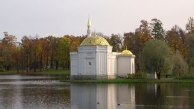 The Turkish bath pavilion on the bank of a pond, cloudy october day. Tsarskoye Selo. The Turkish bath pavilion on the bank of a pond, cloudy october day stock video