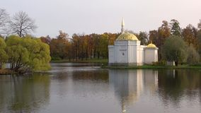 The Turkish bath pavilion on the Big pond, Tsarskoye Selo. Saint-Petersburg. SAINT PETERSBURG, RUSSIA - OCTOBER 17, 2017: The Turkish bath pavilion on the Big stock video footage
