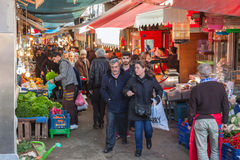 Turkish bazaar street view with sellers and crowd of buyers Royalty Free Stock Photo