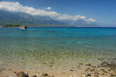 Turkish beach and Taurus mountains. Kemer, Turkey Stock Photos
