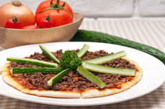 Turkish beef pizza with cucumber on top Stock Photos