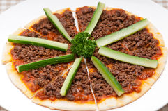 Turkish beef pizza with cucumber on top Stock Images
