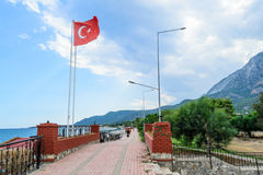 Turkish Beldibi. Tourist city in Turkey. Quay Beldibi mountains in the background with the Turkish flag Stock Photography
