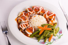 Turkish Beyti Kebap Garnished with Vegetables Royalty Free Stock Photos