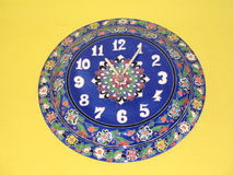 Turkish blue clock. Against yellow background Stock Photos