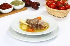 Turkish bony lamb soup with carrot. Kuzu Haslama - Lamb leg soup with carrot - Turkish Soups. Cooking beef broth with onions and carrots royalty free stock photos