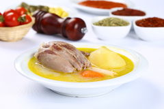 Turkish bony lamb soup with carrot. Kuzu Haslama - Lamb leg soup with carrot - Turkish Soups. Cooking beef broth with onions and carrots stock photos