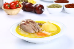 Turkish bony lamb soup with carrot. Kuzu Haslama - Lamb leg soup with carrot - Turkish Soups. Cooking beef broth with onions and carrots royalty free stock images