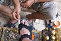 Turkish bootblack at work Royalty Free Stock Photo