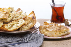 Turkish borek served at a party. With cut portions heaped on a plate showing the crispy flaky texture of the yufka,or phyllo, pastry Stock Photography