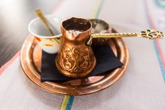 Turkish or Bosnian coffee. Served  in a traditional copper pot Stock Image