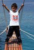 Ä Turkish boy on a cruise ship near Kekova in Turkey. Royalty Free Stock Photography