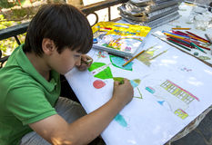 A Turkish boy draws various objects during an art class in Bursa in Turkey. Royalty Free Stock Photos