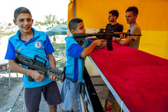 Turkish boys at a shooting gallery in Edirne in Turkey. Royalty Free Stock Images
