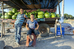 Turkish boys wait for customers at their watermelon stall. Royalty Free Stock Images