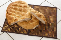 Turkish bread. Two big Turkish loafs on place mats of twined reed Royalty Free Stock Photos
