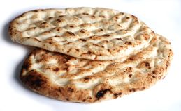 Turkish bread. Side view of two pieces of traditional Turkish unleavened bread Royalty Free Stock Image