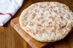 Turkish Bread Bazlama on wooden surface. Stock Image