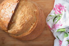 Turkish Bread. Close up of Turkish round bread on cutting board Royalty Free Stock Images