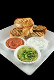 Turkish Bread And Dips. Delicious and colorful trio of dips with grilled Turkish bread stock photo