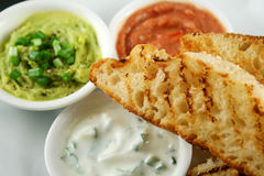 Turkish Bread And Dips 6. Delicious and colorful trio of dips with grilled Turkish bread stock image
