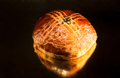 Turkish bread with sesame seeds on a table with reflective surfa Royalty Free Stock Photos