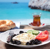 Turkish breakfast against a beach Royalty Free Stock Photos