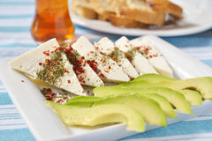 Turkish breakfast. With cheese, avocado, spices, and tea royalty free stock image