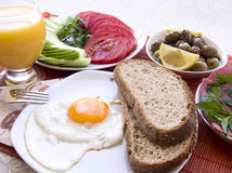 Turkish breakfast table, eggs, salami, bread Royalty Free Stock Images