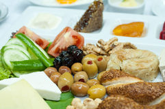 Turkish breakfast. Traditional Turkish breakfast with olives, simit, feta cheese, honey, butter, kaymak and green peppers Stock Images