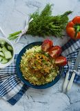 Turkish bulgur pilaf with meatballs and greens. Tasty homemade food close up royalty free stock image