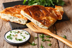 Turkish burek stuffed with spinach and cheese with sour cream sa Stock Images