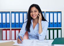 Turkish businesswoman with phone at office stock images