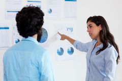 Turkish businesswoman talking with businessman about strategy stock images