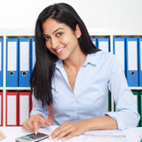 Turkish businesswoman working with calculator at office Royalty Free Stock Image