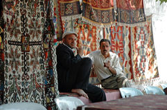 Turkish carpet vendors selling their carpets Stock Photo