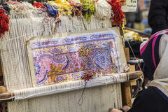 Turkish carpet weaver weaves on a loom on the streets Royalty Free Stock Photography