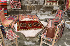 Turkish carpets and leather handbags Royalty Free Stock Photography