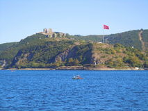 Turkish castle on hill and flag Stock Photography