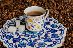 Turkish ceramics in ancient style. Morning cup of coffee on carved platter Royalty Free Stock Image