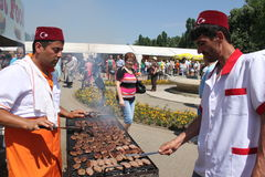 Turkish chefs cooking grilled meat. At Turkish Festival 2103,Bucharest,Romania Royalty Free Stock Image