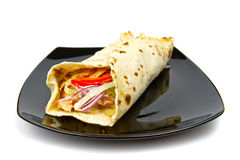 Turkish chicken doner kebab on plate. Turkish chicken doner kebab in wrap on plate Stock Photo