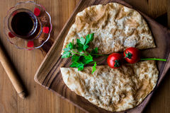 Turkish Cig Borek / Tatar Pie with minced meat and tea. Stock Photos